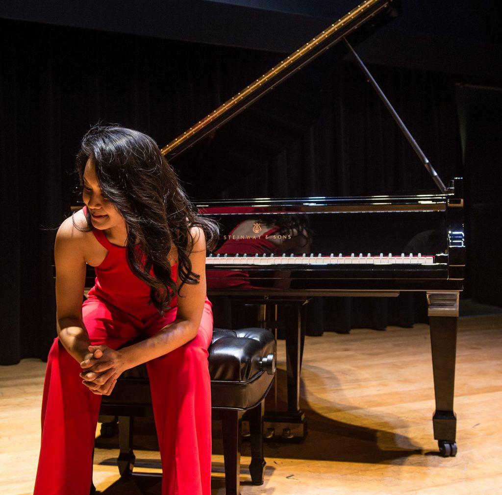 Yuko Sitting at Piano